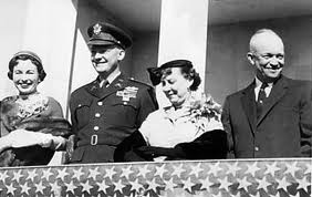 Barbara and John Eisenhower join Mamie and Dwight Eisenhower at a public ceremony,